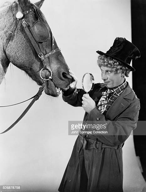 Harpo Marx Examining Horse with a Magnifying Glass