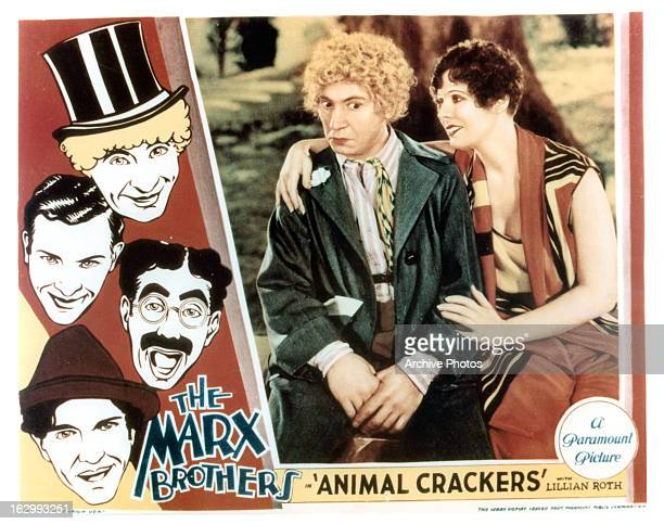Harpo Marx sits with a woman in movie art for the film 'Animal Crackers' 1930