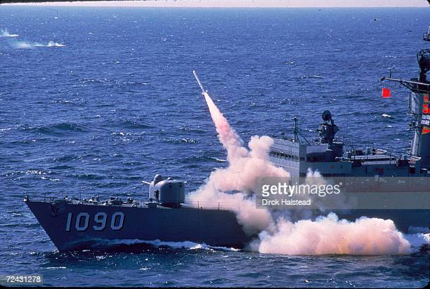 Harpoon anti-ship missile being fired from a fast fragate at sea.