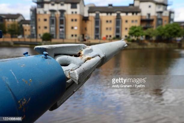 harpoon tip overlooking waterfront - spear stock pictures, royalty-free photos & images