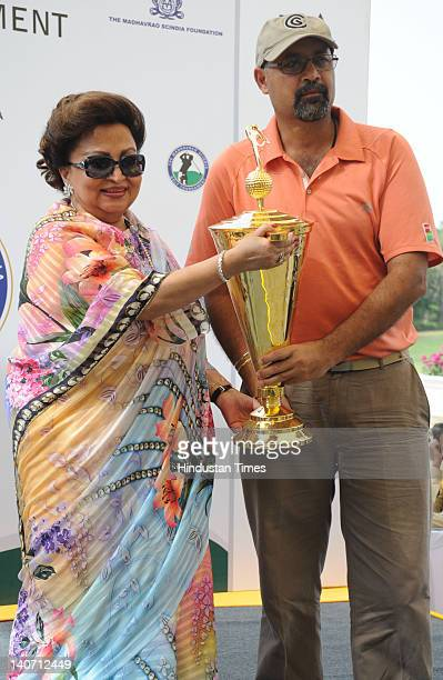 Harpreet Duggal receives winner trophy of 7th edition of Madhavrao Scindia Golf Tournament from Madhavi Raje Scindia at Golf and Country club on...