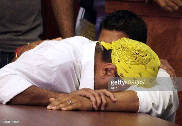 Harpreet Singh weeps during a press conference August 6 2012 in Oak Creek Wisconsin about the shootings Sunday at the Sikh Temple of Wisconsin The...