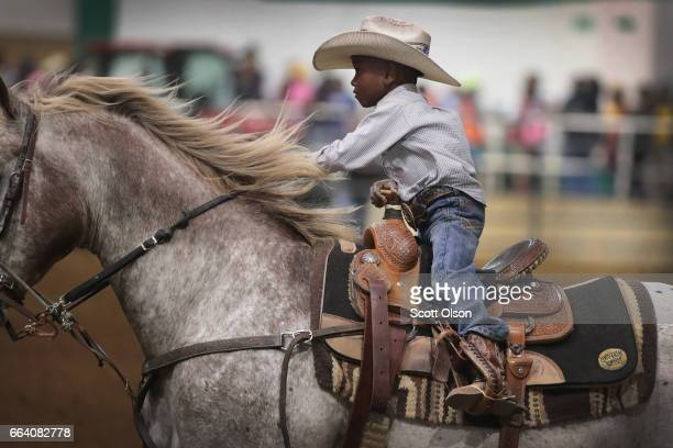 Harrel Williams Jr competes in the junior barrel racing event at the Bill Pickett Invitational Rodeo on March 31 2017 in Memphis Tennessee The Bill...