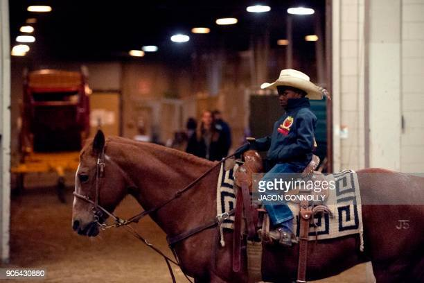 Harrel Williams Jr of Prairie View Texas rides his horse in the stalls before the MLK Jr African American Heritage Rodeo at the National Western...