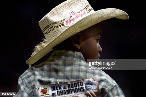 Harrel Williams Jr of Prairie View Texas watches his father compete in the Men's Tie Down Calf Roping competition during the MLK Jr African American...