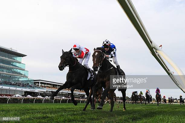 Harrey Coffey riding Glorious Sinndar defeats Regan Bayliss riding The Bandit in Race 7 the Andrew Ramsden Stakes during Melbourne racing at...