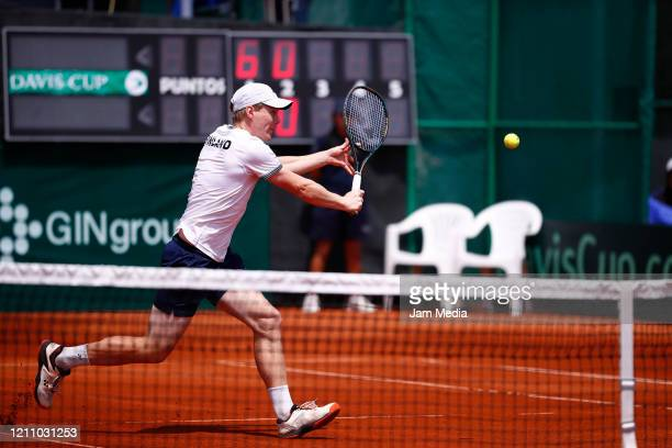 Harri Heliovaara of Finland returns the ball during the fourth match as part of day 2 of Davis Cup World Group I Play-offs at Club Deportivo La...