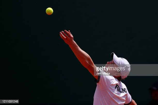 Harri Heliovaara of Finland serves during the fourth match as part of day 2 of Davis Cup World Group I Play-offs at Club Deportivo La Asuncion on...
