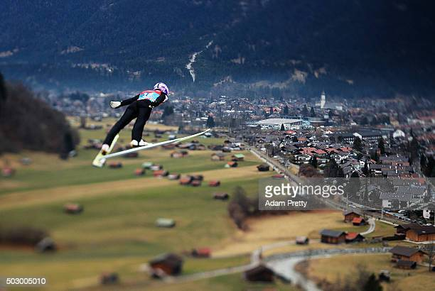 Harri Olli of Finland soars through the air during his practice jump on Day 1 of the 64th Four Hills tounament on December 31 2015 in...