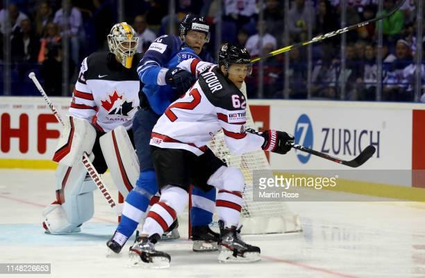 Harri Pesonen of Finland challenges Brandon Montour of Canada during the 2019 IIHF Ice Hockey World Championship Slovakia group A game between...