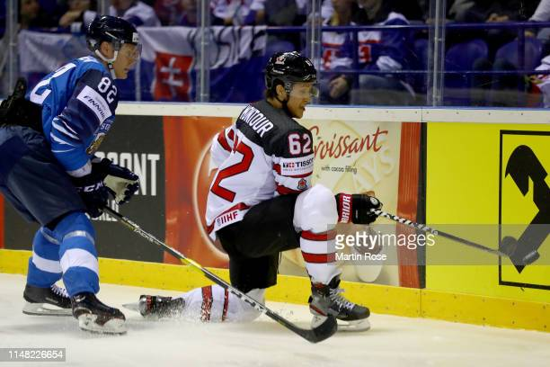 Harri Pesonen of Finland challenges Brandon Montour of Canada during the 2019 IIHF Ice Hockey World Championship Slovakia group A game between...