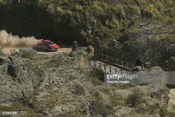 Harri Rovanpera and Risto Pietilainen of Finland in action in the Peugeot 307 during the Third Leg Final of the WRC Rally Argentina on July 18 2004...