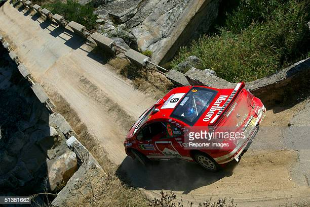 Harri Rovanpera of Finland drives his Peugeot 307 WRC during day 1 of the Rally of Italy on October 1 2004 in Sardinia Italy