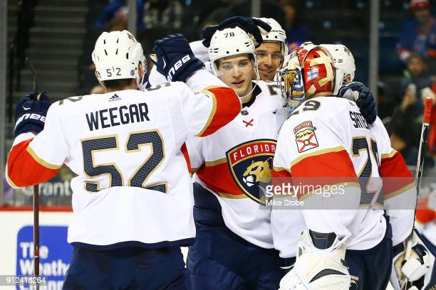 Harri Sateri MacKenzie Weegar and Maxim Mamin of the Florida Panthers celebrate following a 41 win against the New York Islanders at Barclays Center...
