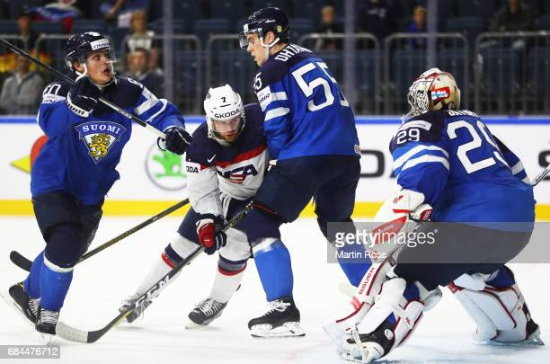 Harri Sateri of Finland is pressured by Jordan Greenway of the USA during the 2017 IIHF Ice Hockey World Championship Quarter Final game between USA...