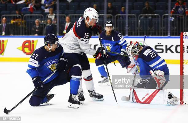 Harri Sateri of Finland saves a shot by Jack Eichel of the USA during the 2017 IIHF Ice Hockey World Championship Quarter Final game between USA and...