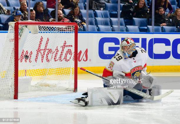 Harri Sateri of the Florida Panthers looks back at a goal scored by Zemgus Girgensons of the Buffalo Sabres during the second period of an NHL game...