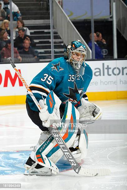 Harri Sateri of the San Jose Sharks protects the net against the Phoenix Coyotes during a preseason NHL game at SAP Center on September 21 2013 in...