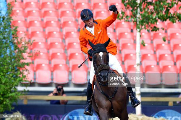 Harrie Smolders riding Don VHP Z celebrates after winning silver medal during Jumping Individual Final of the Equestrian European Championships on...
