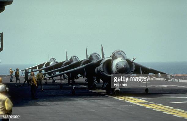 Harrier aircraft line the flight deck of a US Navy ship in the Persian Gulf during Operation Desert Shield September 1990