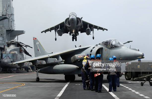 Harrier jet of 1 Joint Force Squadron hovers as it comes in to land on the flight deck of HMS Ark Royal during Exercise Auriga on July 14 2010 at sea...