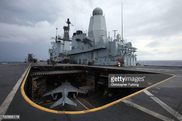 Harrier jet of 1 Joint Force Squadron is lifted to the flight deck of HMS Ark Royal during Exercise Auriga on July 14 2010 at sea in Onslow Bay near...