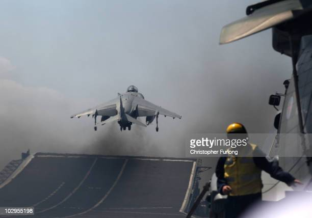 Harrier jet of 1 Joint Force Squadron takes off from the flight deck of HMS Ark Royal during Exercise Auriga on July 14 2010 at sea in Onslow Bay...