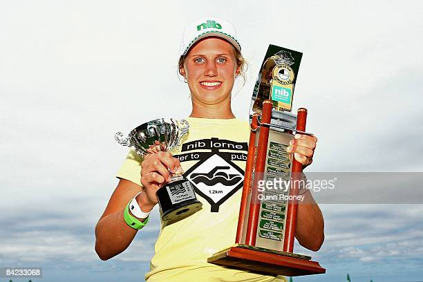 Harriet Brown of Victoria poses with her trophies after winning the Female Open category during the Lorne Pier To Pub open water swim at Louttit Bay...