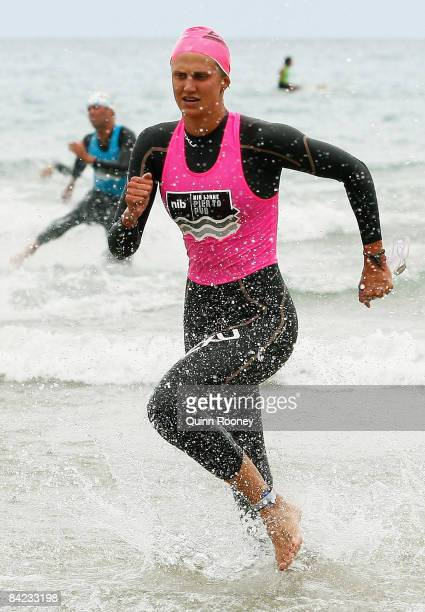 Harriet Brown of Victoria runs out of the water to win the Female Open during the Lorne Pier To Pub open water swim at Louttit Bay January 10 2009 in...