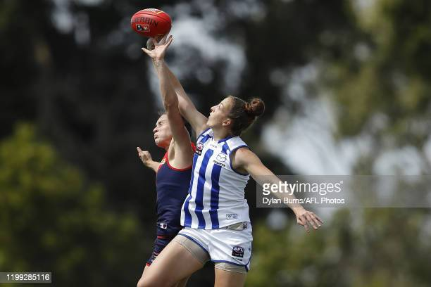 Harriet Cordner of the Demons and Emma King of the Kangaroos compete for the ball during the 2020 AFLW Round 01 match between the Melbourne Demons...