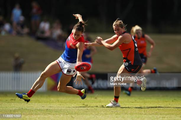 Harriet Cordner of the Demons and Jacinda Barclay of the Giants compete for the ball during the round five AFLW match between the Greater Western...