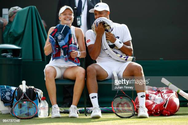 Harriet Dart and Jay Clarke of Great Britain smile between games during their Mixed Doubles second round match against Max Mirnyi of Belarus and...