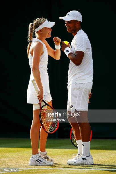 Harriet Dart and Jay Clarke of Great Britain talk tactics during their Mixed Doubles second round match against Max Mirnyi of Belarus and Kveta...