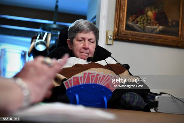 Harriet Fridkin contemplates her cards during a game of bridge at home December 06 2017 in Potomac MD Fridkin who has multiple sclerosis has a large...