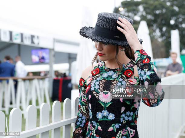 Harriet Hall wearing Nerida Winter boater, Thurley from GlamCorner dress and hair by Toni & Guy, poses at TAB Everest Day at Royal Randwick...
