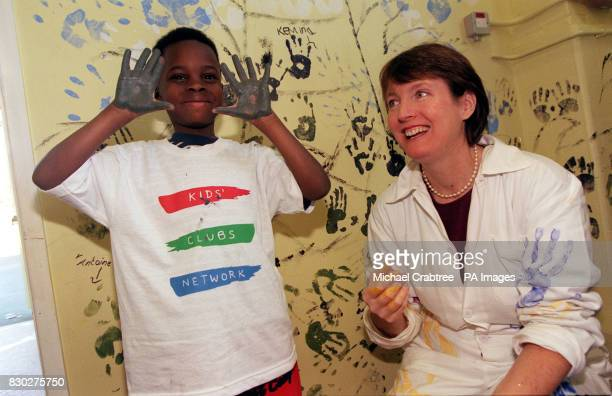 Harriet Harman MP with six year old Lathan Davis painting a mural in The Lighthouse Club in Peckham London The Lighthouse Club secured the first...