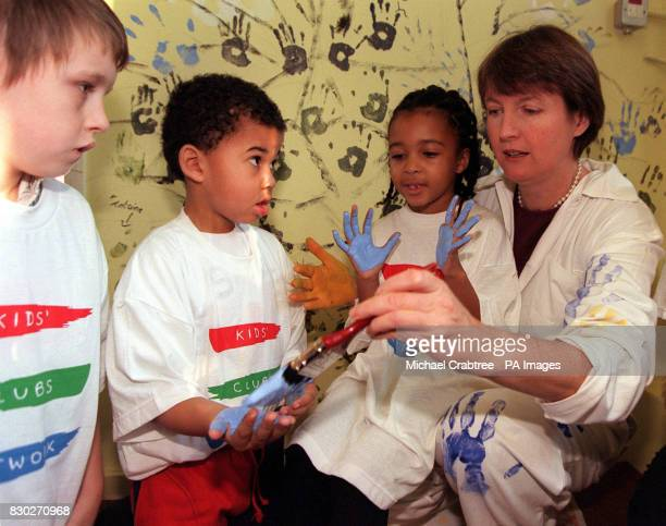 Harriet Harman MP with the aid of unnamed children paints a mural in The Lighthouse Club in Peckham LondoN at the launch of the Nescafe Getting...