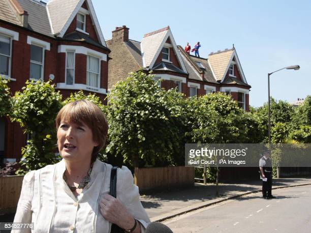 Harriet Harman, the deputy leader of the Labour Party leaves her house as two Fathers 4 Justice campaigners continue their protest on the roof of her...