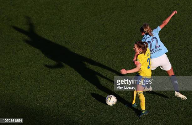 Harriet Scott of Birmingham City Women is challenged by Claire Emslie of Manchester City Women during the FA WSL match between Manchester City Women...