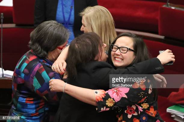 Harriet Shing MP and Colleen Hartland MP react as the bill passes inside of the Parliament of Victoria after the Upper House voted to pass historic...