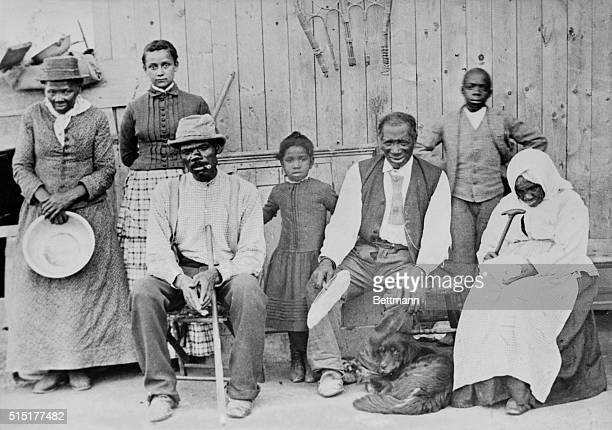 Harriet Tubman American abolitionist photographed with a group of slaves she helped escape SA