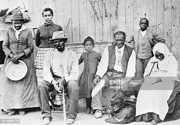 Harriet Tubman photographed with a group of slaves whose escape she assisted.