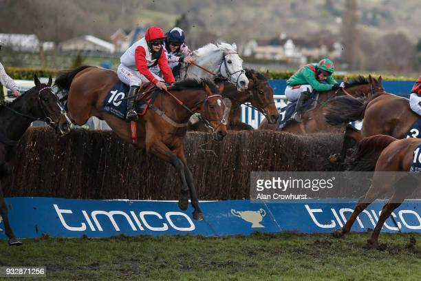 Harriet Tucker riding Pacha Du Polder clear the last to win The ST James Place Foxhunter Challenge Cup Open Hunters' Steeple Chase at Cheltenham...