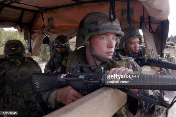 Harrington of the U.S. Army 3rd Infantry Division, 3rd Forward Support Battalion prepares to train in small-unit tactics for defending their convoy...