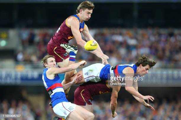 Harris Andrews of the Lions and Patrick Lipinski of the Bulldogs compete for the ball during the round 20 AFL match between the Brisbane Lions and...