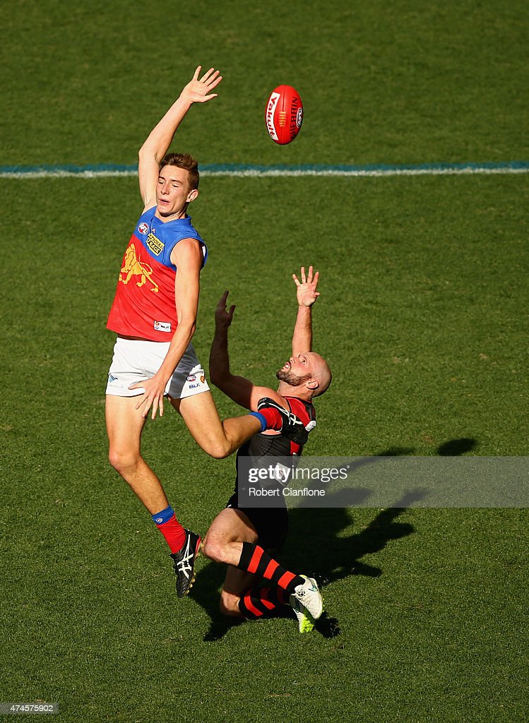 Harris Andrews of the Lions is challenged by Paul Chapman of the Bombers during the round eight AFL match between the Essendon Bombers and the Brisbane Lions at Etihad Stadium on May 24, 2015 in Melbourne, Australia.