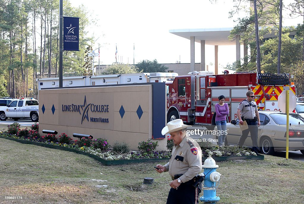 Harris County Sheriff Officers work the scene at Lone Star Campus after a shooting occurred on January 22, 2013 in The Woodlands, Texas. According to reports, three people were injured during a shooting on the courtyard between the Library and cafeteria.