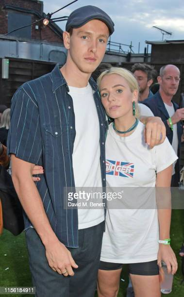 Harris Dickinson and Rose Gray attend the Warner Music summer drinks on July 17 2019 in London England
