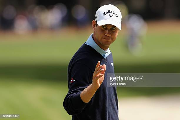 Harris English acknowledges the gallery on the 9th green during the first round of the RBC Heritage at Harbour Town Golf Links on April 17, 2014 in...