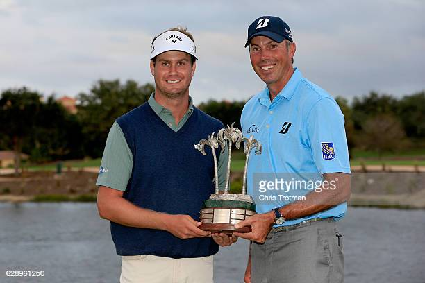 Harris English and his teammate Matt Kuchar pose with the tournament trophy following their victory after the final round of the Franklin Templeton...